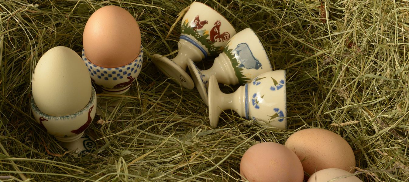 Fragrant hay, fresh eggs and egg cups